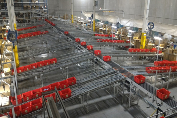 Red bins on metal trays Newegg Logistics