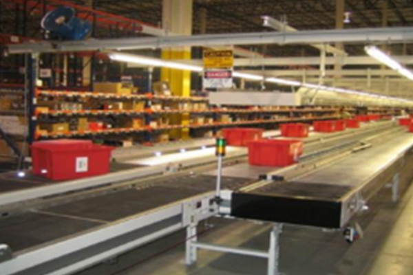 Red bins on stop and go conveyor belts Newegg Logistics