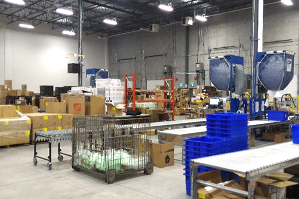 Boxes and bins inspection table Newegg Logistics