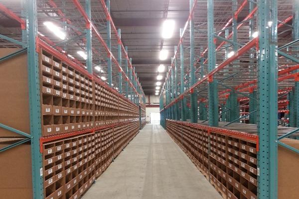 Metal organized aisle walkways in warehouse Newegg Logistics