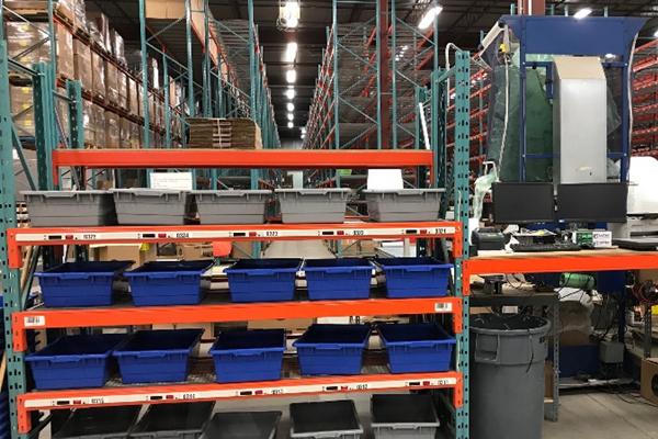 Blue and grey bins Newegg Logistics