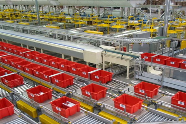 Newegg Los Angeles fulfillment center red bins on conveyor belts