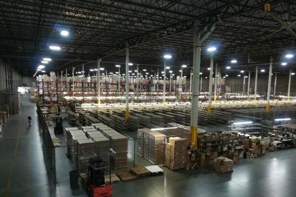 Night view of inside warehouse lights on Newegg Logistics
